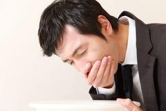 Homme d'affaires de vomissement Photographie stock