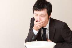 Homme d'affaires de vomissement Image stock