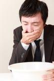 Homme d'affaires de vomissement Images stock