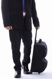 Homme d'affaires de voyage tenant le bagage Photo stock
