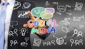 Homme d'affaires dessinant le concept social de media Images stock