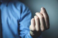 Homme d'affaires dirigeant des doigts Concept d'affaires photo stock