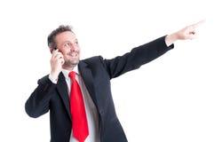 Homme d'affaires dirigeant le doigt jusqu'à l'avenir Photographie stock libre de droits