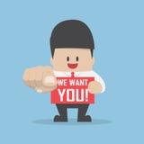 Homme d'affaires dirigeant le doigt vers vous avec le mot nous vous voulons Photo stock