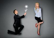 Homme d'affaires donnant la fleur Photographie stock
