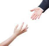 Homme d'affaires donnant le coup de main aux pauvres priant la personne dans le besoin Photos libres de droits
