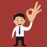 Homme d'affaires donnant le signe correct Image stock