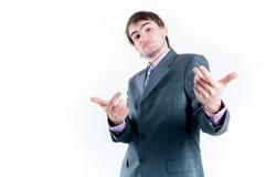 Homme d'affaires drôle gesticulant Photographie stock libre de droits