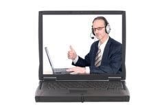 Homme d'affaires effectuant la conférence téléphonique d'Internet Photos stock