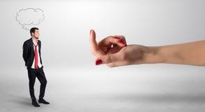Homme d'affaires embrassé avec le concept de amorce de main Image stock