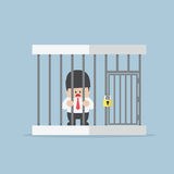 Homme d'affaires emprisonné dans une cage Images stock