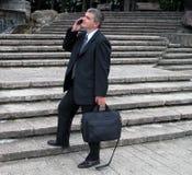 Homme d'affaires en stationnement Images libres de droits