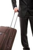 Homme d'affaires en voyage avec une valise Images libres de droits
