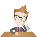 Homme d'affaires ennuyé avec de la toile d'araignée Photo stock