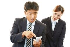 Homme d'affaires et femme d'affaires étonnés Photo libre de droits