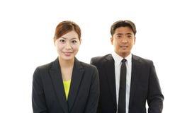 Homme d'affaires et femmes d'affaires de sourire Image stock