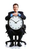 Homme d'affaires et horloge image stock
