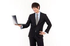 Homme d'affaires et ordinateur portatif. Photographie stock libre de droits