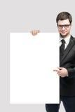 Homme d'affaires et panneau blanc Photo stock
