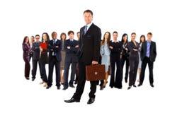 Homme d'affaires et son équipe d'isolement Photographie stock