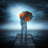 Homme d'affaires et tempête en mer Images stock