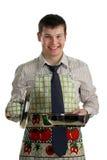 Homme d'affaires faisant cuire la nourriture Photographie stock