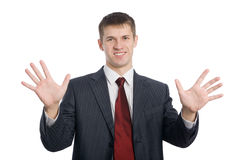 Homme d'affaires faisant des gestes des mains Image stock
