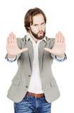 Homme d'affaires faisant le signe d'arrêt avec la main émotions et les gens concentrés Photos libres de droits