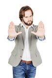 Homme d'affaires faisant le signe d'arrêt avec la main émotions et les gens concentrés Photo libre de droits