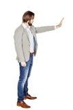 Homme d'affaires faisant le signe d'arrêt avec la main image sur un studio blanc Images stock