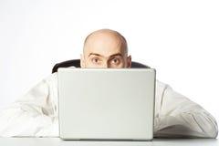 Homme d'affaires faisant une pointe au-dessus du dessus Photographie stock libre de droits