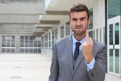 Homme d'affaires fol montrant la rage avec le doigt moyen Image libre de droits