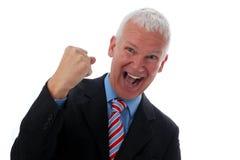 Homme d'affaires fou avec le poing Photos stock