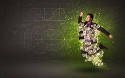 Homme d'affaires gai sautant avec des billets de banque du dollar autour de lui Photographie stock libre de droits