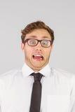 Homme d'affaires Geeky regardant l'appareil-photo Photographie stock libre de droits