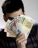 Homme d'affaires heureux avec le paquet d'euro argent Photographie stock