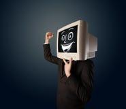 Homme d'affaires heureux avec une tête de moniteur de PC et un visage souriant Images libres de droits