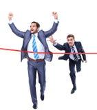 Homme d'affaires heureux courant par la ligne d'arrivée Photos libres de droits