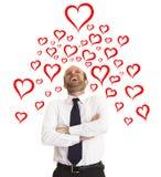 Homme d'affaires heureux dans l'amour Photos stock