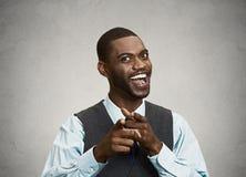 Homme d'affaires heureux dirigeant des doigts à vous Images stock