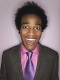 Homme d'affaires heureux drôle d'Afro Image stock