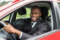 Homme d'affaires heureux Driving Car image libre de droits