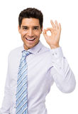 Homme d'affaires heureux Gesturing Okay photos stock
