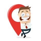 Homme d'affaires heureux se penchant sur un indicateur de carte Image libre de droits