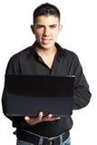Homme d'affaires hispanique avec l'ordinateur portatif Photos stock