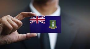 Homme d'affaires Holding Card de drapeau des Îles Vierges britanniques image libre de droits