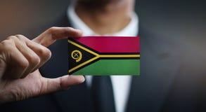 Homme d'affaires Holding Card de drapeau du Vanuatu photo libre de droits