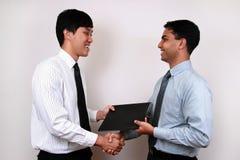 Homme d'affaires indien et chinois. photographie stock