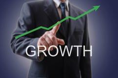 Homme d'affaires indiquant la croissance Image libre de droits
