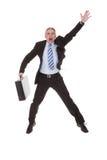 Homme d'affaires inquiété Hailing une cabine Photos stock